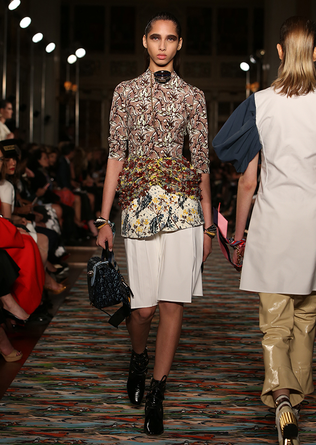 Embroidered two-print top with a printed wool peplum and white cotton skirt