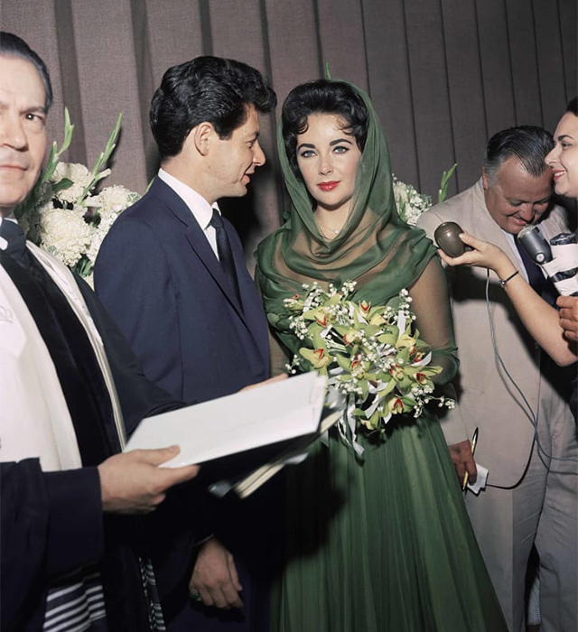 Elizabeth Taylor wore a green wedding dress for her wedding to singer Eddie Fisher. Credit: AP Photo