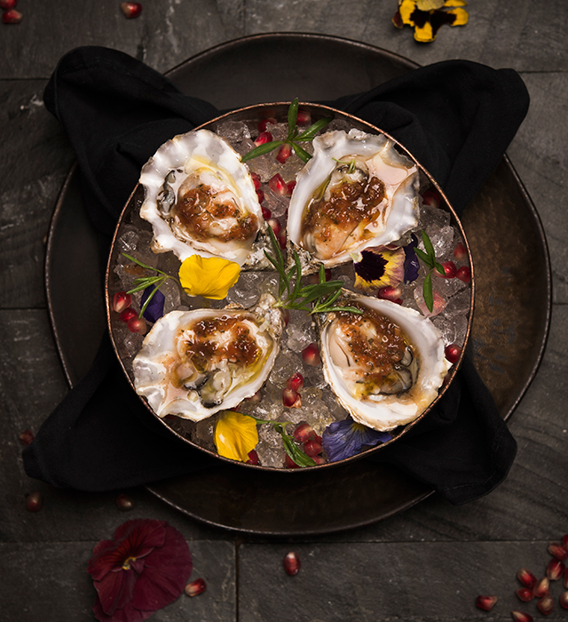 'Loch fyne' oysters on ice with tomato, citrus and pomegranate