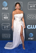 Chrissy Teigen dressed in Maison Yaya