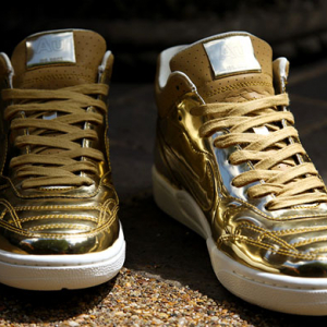 Nike's golden Tiempo '94 Mid SP shoes