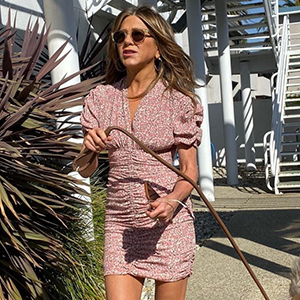 Only Jennifer Aniston could make a dog-walking-selfie look this chic