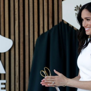 The Duchess of Sussex debuts baby bump in Karen Gee