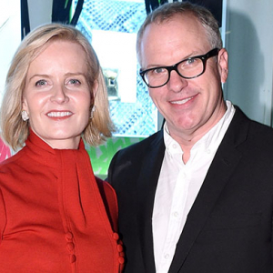 Donald Drawbertson and Kara Ross toast their handbag collaboration in New York
