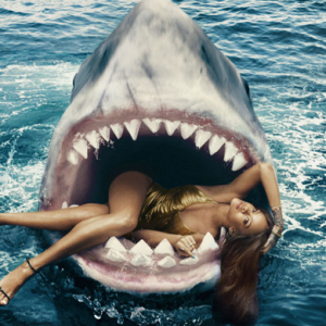 Rihanna poses inside a shark's mouth for Harper's Bazaar