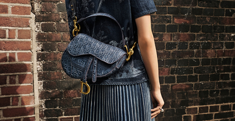 Dior's beloved Saddle bag is now available in embroidered denim