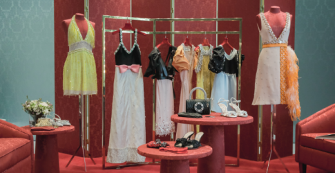 Upcycled by Miu Miu, a collection of reworked vintage dresses