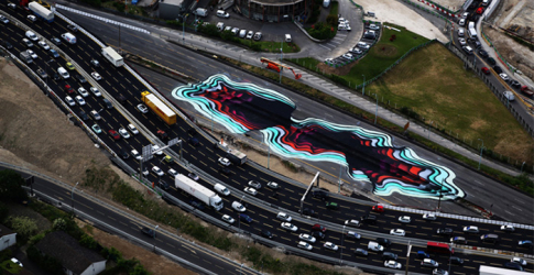 Take a look at this optical illusion street art on a Paris highway