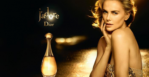 Going for gold: Charlize Theron dazzles in new Dior J'Adore perfume campaign