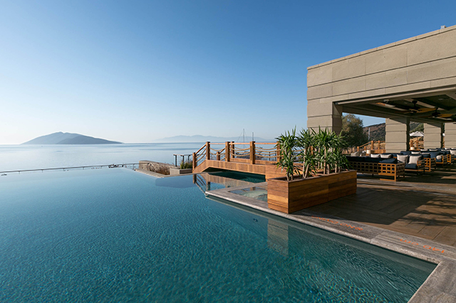 Caresse Bodrum, Turkey. Perched on the hills of the charming contemporary fishing town, the hotel offers unrivalled bespoke services to ensure the best experience in Bodrum in addition to excellent hospitality. For reservations, call +90 252 311 3636.