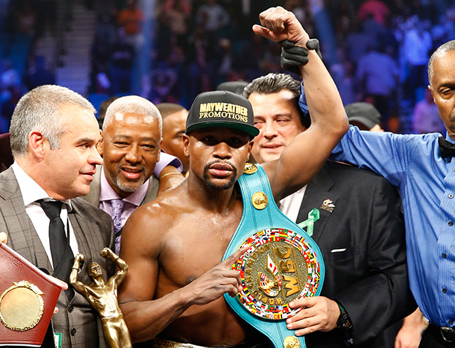 Floyd Mayweather beats Manny Pacquiao in the biggest fight of the decade