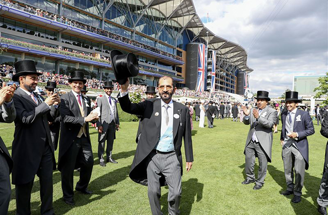 Sheikh Mohammed bin Rashid Al Maktoum receives trophy from Queen Elizabeth II at Royal Ascot