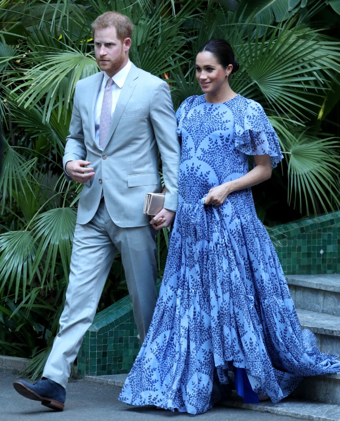 The Duchess of Sussex stuns in a blue Carolina Herrera maxi dress to meet Morocco's King Mohammed VI