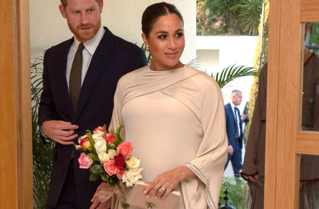 The Duchess of Sussex is dropping a lot of joy in this custom Dior cape