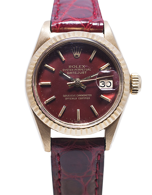 "799 Vintage Rolex Lady Datejust Reference 6917 of 1978 18K Gold Has an oxblood colored enamel dial, nicknamed ""Stella dial"""