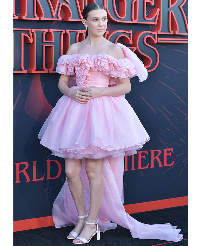 Millie Bobby Brown wears a custom Rodarte silk organza ruffled tutu dress at the 'Stranger Things 3' premiere in LA