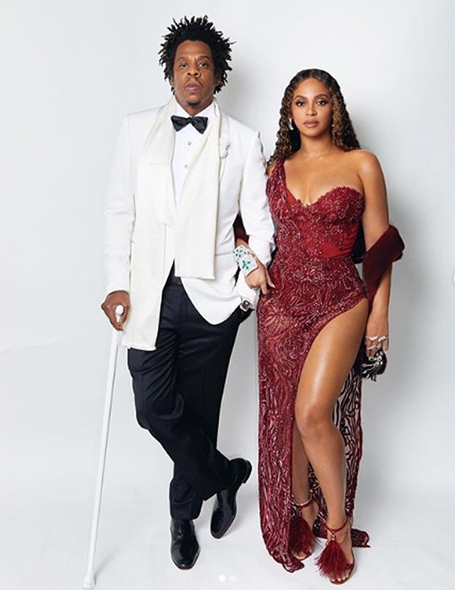 Beyoncé dressed in a stunning red one-shoulder gown