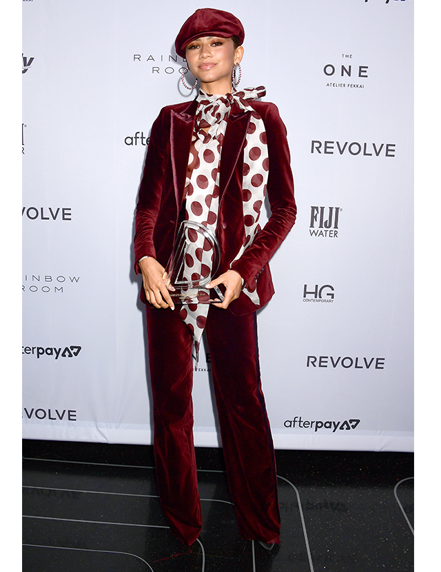 Zendaya wears a velvet burgundy suit from the Tommy Hilfiger x Zendaya collection to the Daily Front Row Awards in New York