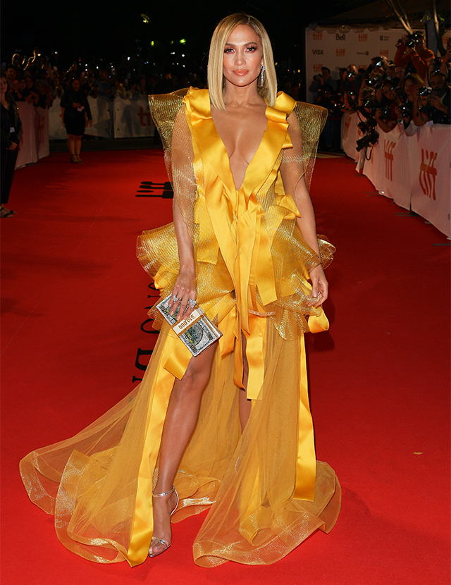 Jennifer Lopez wears a marigold gown by Maison Yeya at the Toronto International Film Festival