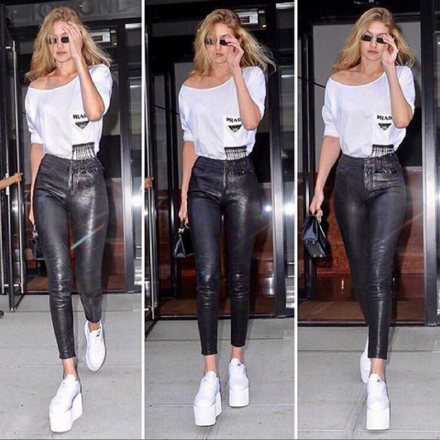 Gigi Hadid carrying the Mini Top Handle 2.0 in Black Lizard