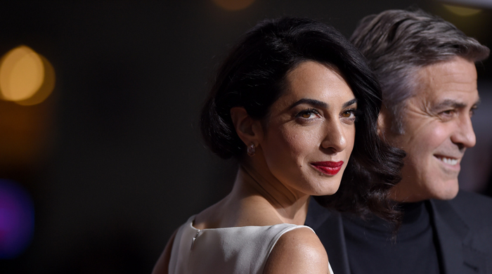 George and Amal Clooney speak to Syrian refugees