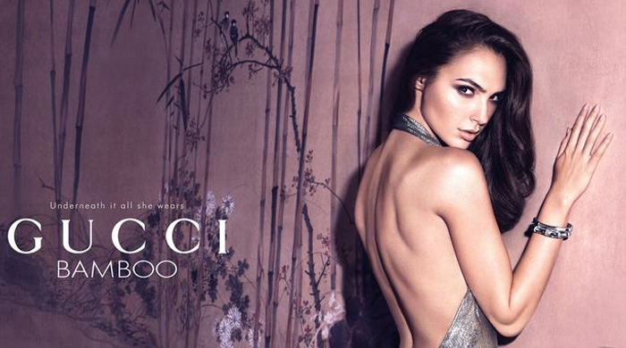 Sensual scent: Gal Gadot poses in backless gown for Gucci Bamboo