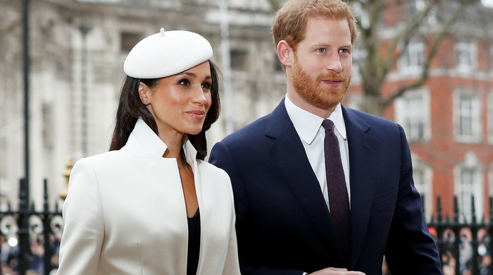 Meghan Markle appears at her first official engagement with the Queen